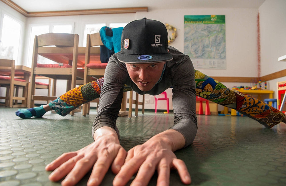Philipp Reiter doing some stretching after a long skitour day. (image: Christian Gamsjäger / Red Bull Content Pool)